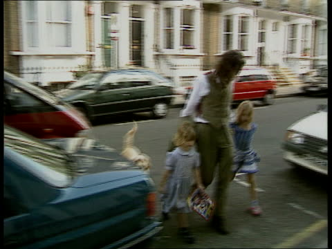 michael hutchence death investigation lib england london bob geldof across road towards with his two children geldof and daughters towards and past... - house husband stock videos & royalty-free footage