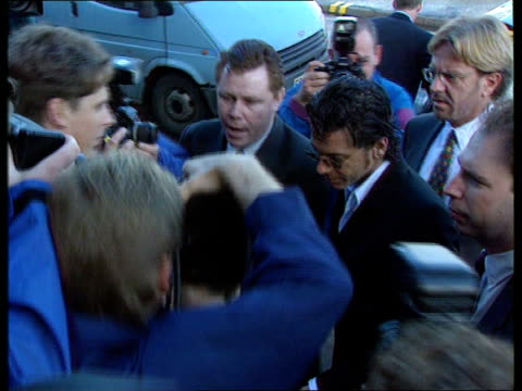 michael hutchence fined for assault england kent maidstone tms michael hutchence arriving at court zoom as gets out of car surrounded by... - maidstone stock videos and b-roll footage