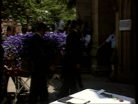 michael hutchence funeral itn australia sydney coffin of hutchence with single tiger lily flower seen amongst mass of blue irises along on trolley... - tiger lily stock videos & royalty-free footage