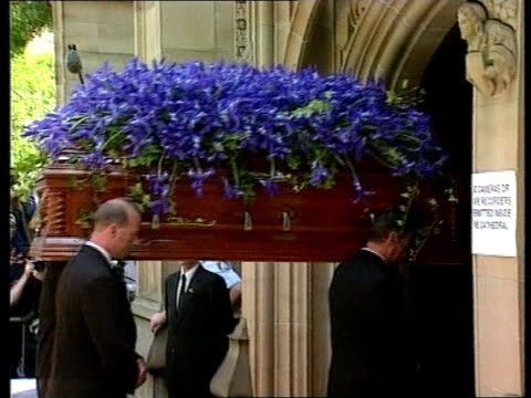 michael hutchence funeral itn coffin of hutchence with a few tiger lily flowers seen amongst mass of blue irises carried into cathedral paula yates... - tiger lily stock videos & royalty-free footage