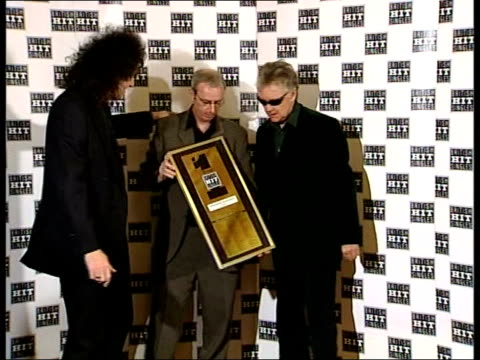 bohemian rhapsody wins award; itn england: london: dominion theatre: int queen members, roger taylor & brian may holding award for britain's... - the dominion theatre stock videos & royalty-free footage
