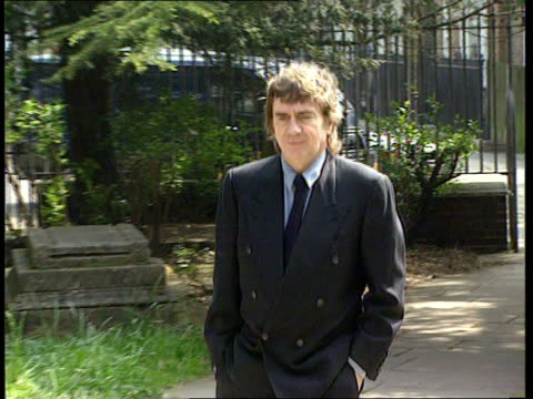 stockvideo's en b-roll-footage met peter cook memorial service **** for england london hampstead lms dudley moore towards along path of st johnathampstead church - dudley moore