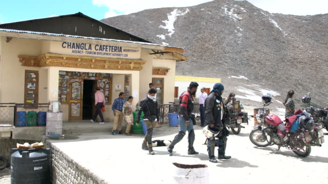 Enthusiastic bikers taking a break at the Chang La Pass, Ladakh, India