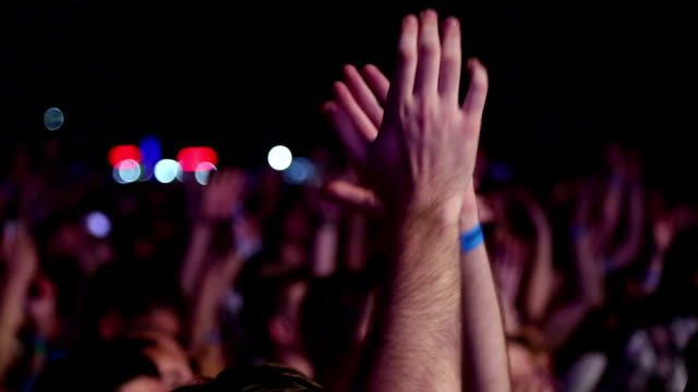 enthusiastic crowd at a rock concert - adulation stock videos & royalty-free footage