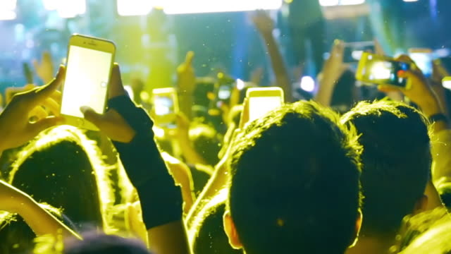 slow-mo: enthusiastic crowd at a rock concert - live event stock videos & royalty-free footage