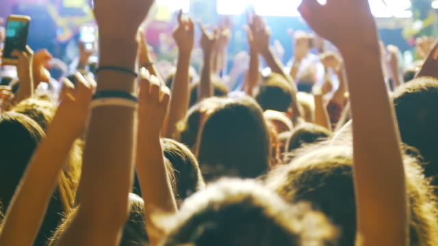 vídeos de stock e filmes b-roll de slow-mo: enthusiastic crowd at a rock concert - evento de entretenimento
