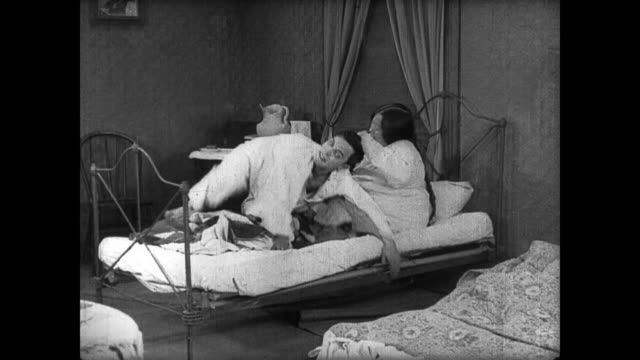 1922 Entire bed collapses onto man (Buster Keaton) before he falls onto irritated woman who promptly starts hitting him
