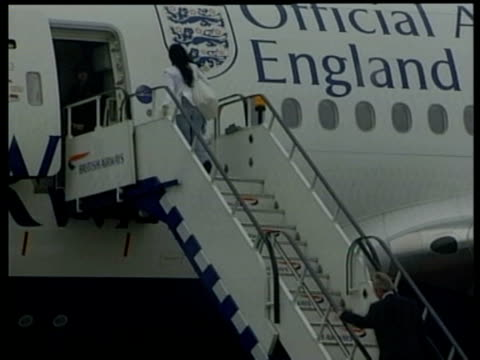 entire england squad posing for photocall on plane steps / luton airport, united kingdom - 2002 stock videos & royalty-free footage