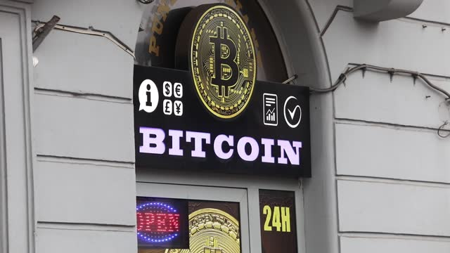 entrance door of the bitcoin exchange shop is seen in krakow, poland on january 5, 2021. - financial accessory stock videos & royalty-free footage