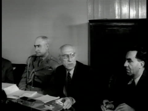 vídeos de stock, filmes e b-roll de entrance gate to the majlis of iran . prime minister dr. mohammed mossadegh sitting at table talking w/ others. - 1951