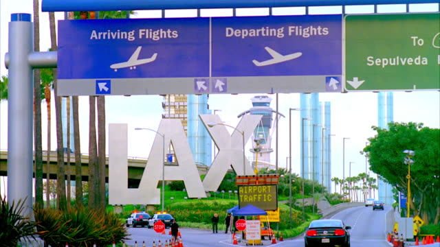 ws entrance of lax with arriving and departing signs, traffic on road / los angeles, california, usa - lax airport stock videos & royalty-free footage
