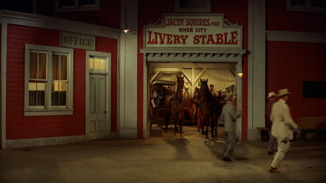 MS Entrance of livery stable people sitting in carts and buggies leaving