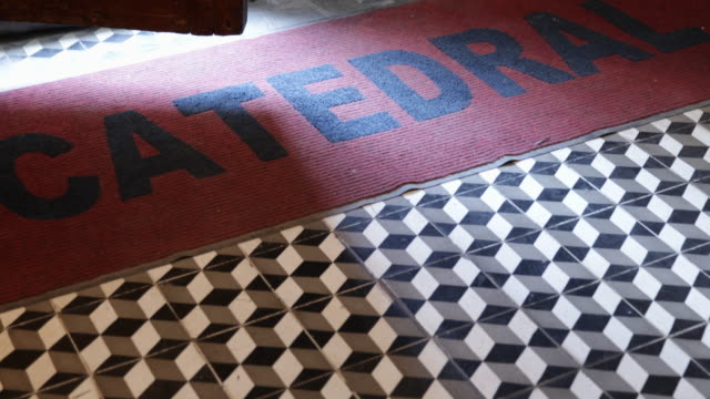 entrance of the metropolitan cathedral in santiago de chile the word catedral is written on the red carpet that is on a triangle pattern floor the... - christian ender stock-videos und b-roll-filmmaterial