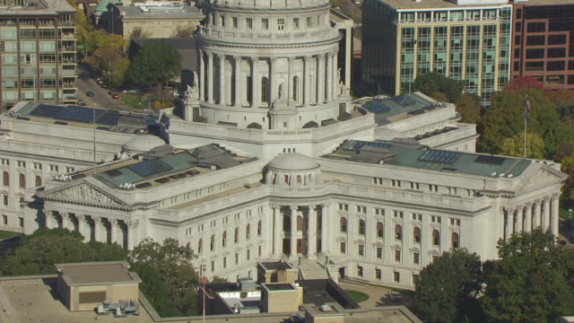WS ZO AERIAL POV Entrance of Wisconsin state capital building, Lake Monona in background / Madison, Wisconsin, United States