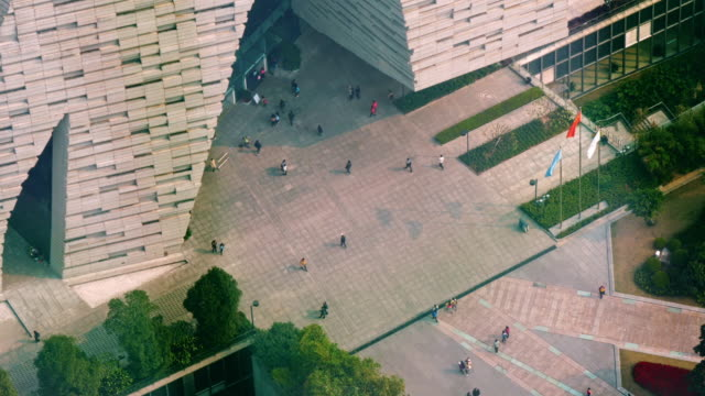 entrance ofguangzhou library in guangzhou, china. narrow shot from above - spoonfilm stock-videos und b-roll-filmmaterial