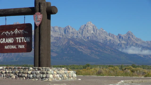 entrance sign and mountains, grand teton national park - entrance sign stock videos & royalty-free footage
