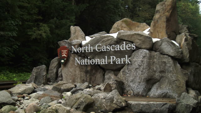 entrance sign for north cascades national park in washington state - entrance sign stock videos & royalty-free footage