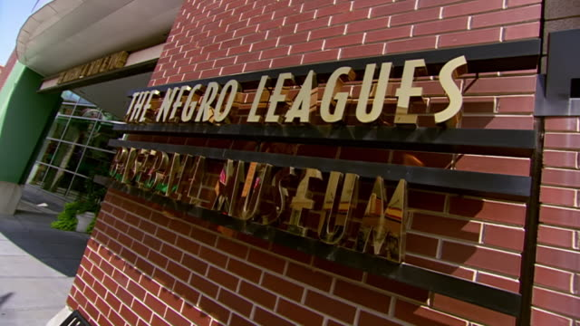 ms ts pan entrance sign of negro leagues baseball museum / kansas city, missouri, united states - sports league stock videos & royalty-free footage