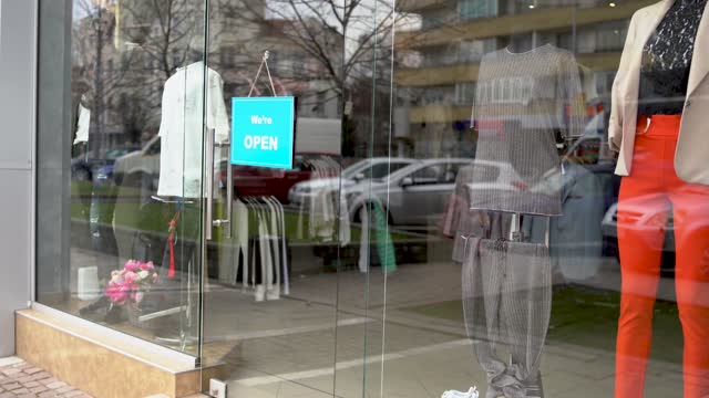 entrance sign on a fashion store is changing from 'closed' to 'open' - entrance sign stock videos & royalty-free footage