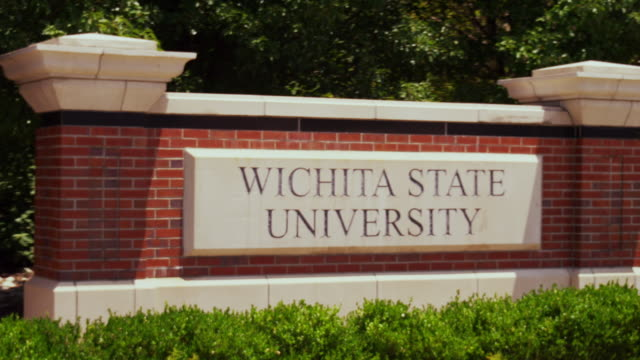 entrance sign to wichita sate univeristy - entrance sign stock videos & royalty-free footage