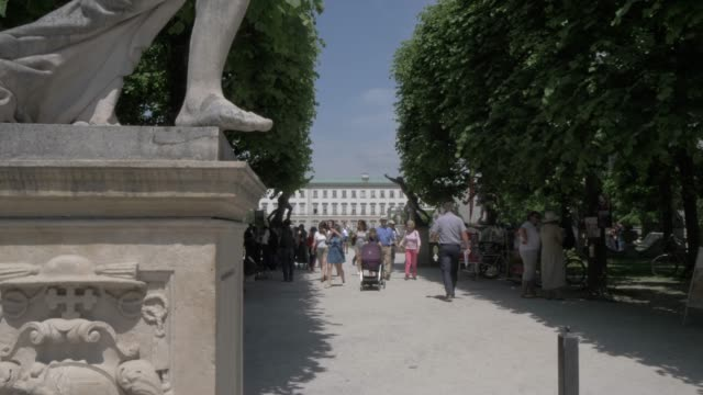 entrance statue in mirabell gardens, unesco world heritage site, salzburg, austria, europe - schlossgebäude stock-videos und b-roll-filmmaterial