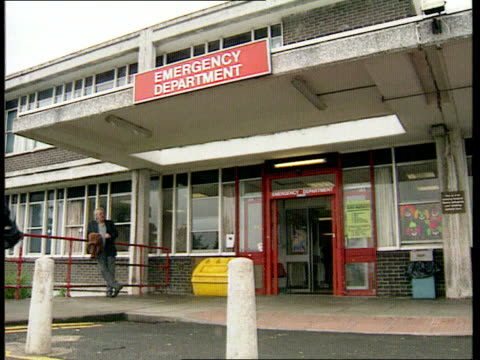 england ext entrance to accident and emergency department int people waiting at reception in accident and emergency nurse applying plaster of paris... - broken leg stock videos & royalty-free footage
