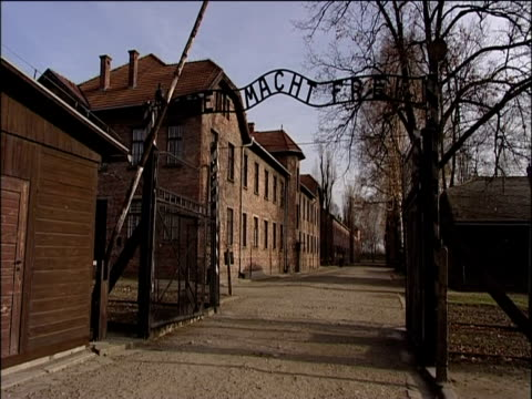Entrance to Auschwitz concentration camp with sign 'Arbeit Macht Frei' 2000