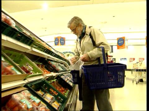 LIB MAT HELD BUREAU ENGLAND EXT GV entrance to branch of Sainsbury's INT SIDE GV man choosing fruit and vegetables