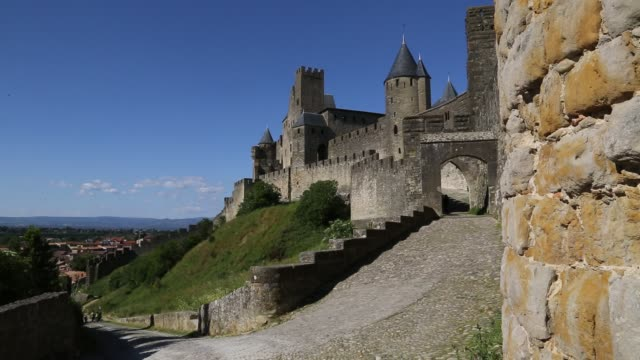 entrance to cité de carcassonne - carcassonne stock videos & royalty-free footage