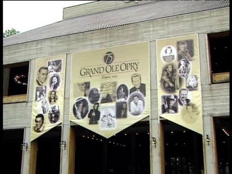 entrance to grand ole opry with large 75th anniversary banner - 75th anniversary stock videos & royalty-free footage