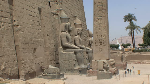 WS Entrance to Luxor Temple with statues of Ramesses II and original obelisk, Luxor, Egypt
