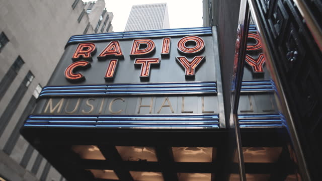 entrance to new york city's iconic radio city music hall. - marquee nightclub manhattan stock-videos und b-roll-filmmaterial