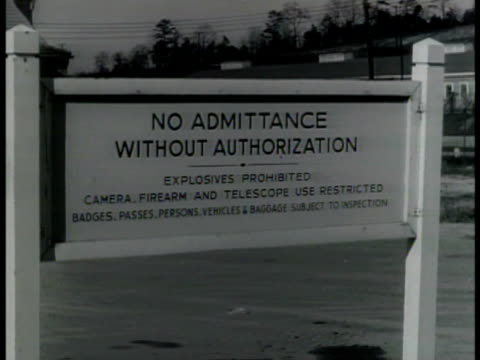 entrance to oak ridge atomic plant tennessee ms sign 'no admittance w/o authorization' ms car pulling up to security guard ms guard checking under... - oak stock videos and b-roll footage