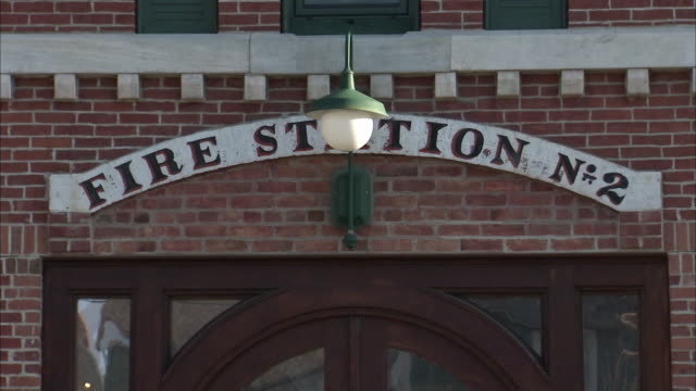 cu entrance to old fire station house / rutland, vermont, usa - fire station stock videos & royalty-free footage