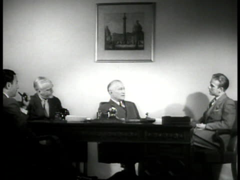 entrance to 'paramount pictures' int ws founder adolph zukor at desk talking w/ two men ms zukor talking w/ man cu motion picture daily newspaper... - paramount studios stock videos & royalty-free footage