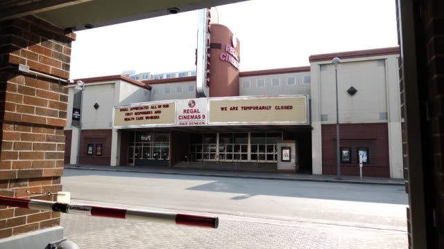 entrance to regal cinemas movie theater seen from across street in oakland. more than 7,000 movie screens will be dark in the u.s. this weekend as... - western script stock videos & royalty-free footage