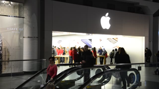 Entrance to the Apple Store in the Eaton Centre in TorontoCanada Shoppers enter and go out the popular business during the Christmas season Original...