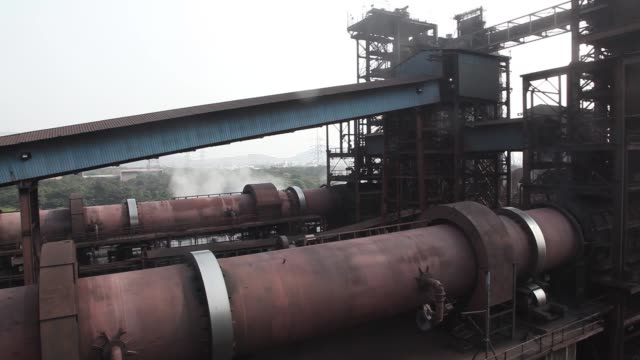 entrance to the direct reduced iron area of the jindal steel & power ltd.'s plant in raigarh, chhattisgargh, india, tuesday, feb. 10 rotary kilns... - burning coal stock videos & royalty-free footage