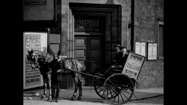stockvideo's en b-roll-footage met 1905 entrance to the empire theatre - kassei