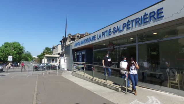entrance to the pitié salpêtrière university hospital charles foix paris 75013 three people with a protective mask mai 6 2020 in paris france - three people stock videos & royalty-free footage