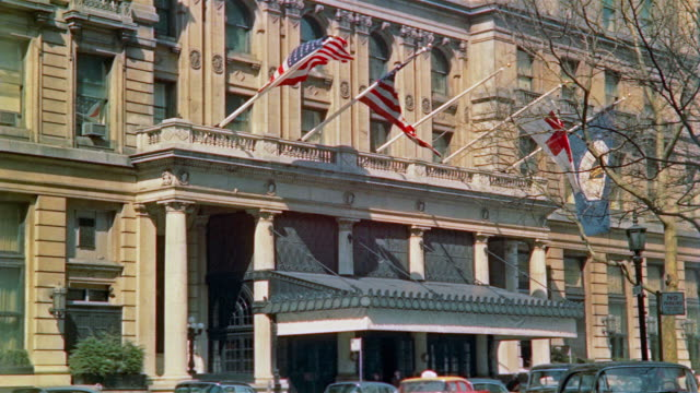 1958 ms entrance to the plaza hotel / td plaza hotel with traffic and pedestrians in foreground / new york city - 1958 stock videos & royalty-free footage
