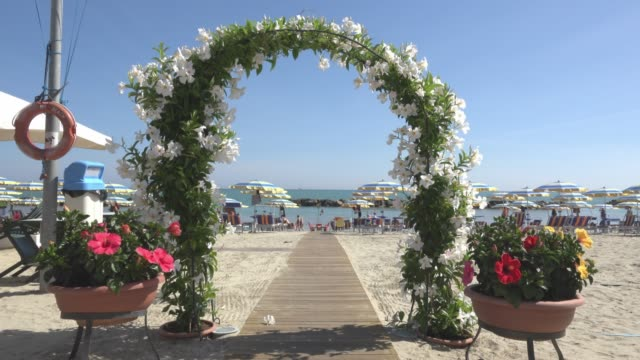 entrance with floral garland to beach at the adriatic sea - adriatic sea stock videos & royalty-free footage