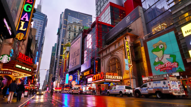 entrances to regal cinemas and amc theaters. colorful billboards. starbucks. vestin. retail and consumer stores. new york. - editorial stock videos & royalty-free footage