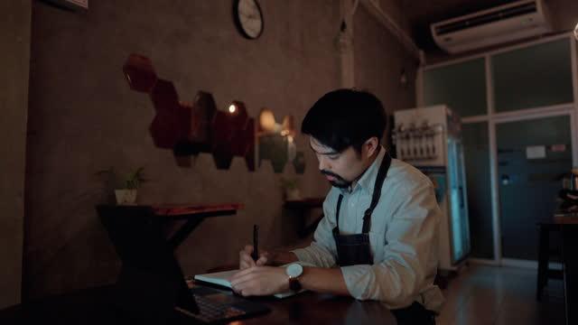 entrepreneur checking on financial bill. - financial advisor stock videos & royalty-free footage