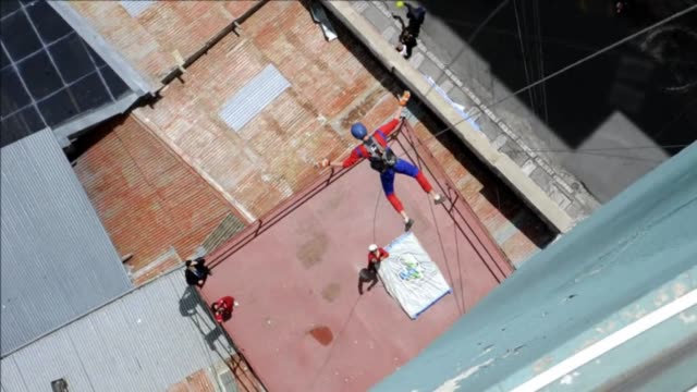 entrepreneur derren patterson originally from the us is hoping attract thrill seeking tourists to la paz bolivia with a new way to see the city... - abseiling stock videos & royalty-free footage