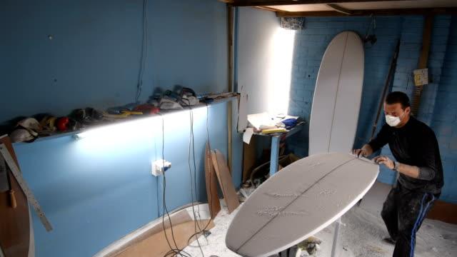 entrepreneur making custom surfboards - surfboard stock videos & royalty-free footage