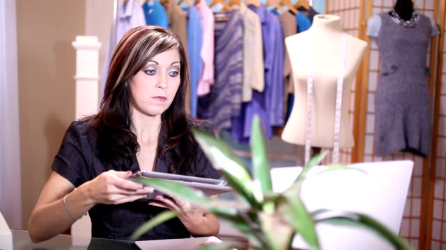 entrepreneur ordering fabric online for her alterations, fashion design shop. - suit jacket stock videos & royalty-free footage
