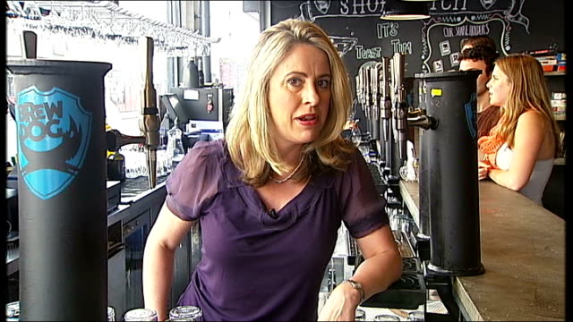 entrepreneurs raise money from peer to peer lending reporter to camera sign in pub showing 'our share holders' tilt down brew dog beer on tap pint of... - empty beer glass stock videos and b-roll footage