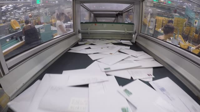 envelopes pass along a conveyor belt at a deutsche post ag postal mail sorting office in frankfurt germany on tuesday aug 4 2015 - post structure stock videos & royalty-free footage