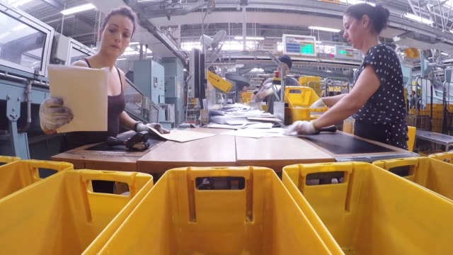 envelopes sit in crates as they move along a mail sorting machine conveyor inside a deutsche post ag postal sorting office in frankfurt, germany, on... - postamt stock-videos und b-roll-filmmaterial